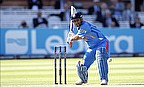 Mahendra Singh Dhoni hits a shot for India