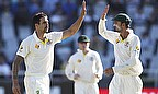 Mitchell Johnson celebrates with Nathan Lyon