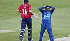 Dilshan (right) is disappointed as Cook continues towards his half-century