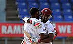 Kraigg Brathwaite and Darren Bravo (facing camera) embrace after the former hit his maiden Test century