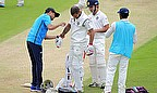 Shikhar Dhawan is tended to after being hit
