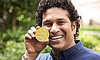 Tendulkar with the new coin minted in his honour