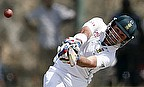 Dean Elgar reaches his century with a six