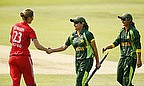 Sana Mir shakes hands with Charltote Edwards
