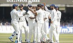 India celebrate the wicket of Alastair Cook