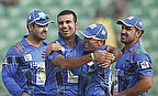 Dawlat Zadran is congratulated by team-mates