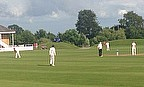 Tom Abell (far right) at the crease during Taunton's win over Frenchay