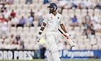 Shikhar Dhawan looks behind after being dismissed