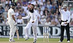 Moeen Ali celebrates the dismissal of Cheteshwar Pujara