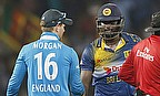 Eoin Morgan (left) has been fined 20 per cent of his match fee