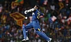Tillakaratne Dishan celebrates his century in the seventh ODI against England