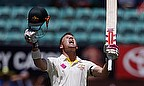 David Warner celebrates reaching a Test century at the SCG for the first time