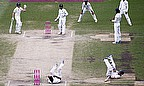 Chris Rogers and Suresh Raina collide