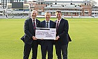 Lord's Taverners CEO Paul Robin and President Chris Cowdrey receive a cheque for £5,250 from Tim Luckhurst at Lord's