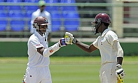 Shiv Chanderpaul gets a high five from allrounder Jeremiah Louis on reaching his century