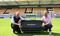 Cambridge United's head groundsman Ian Darler (right) takes delivery of a Dennis G860 mower from Robert Jack, area manager for the company.