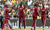 The West Indies celebrate a wicket against South Africa