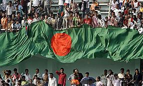 Bangladesh supporters hold up the national flag