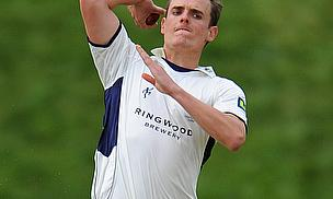 David Griffiths bowls in Hampshire training kit