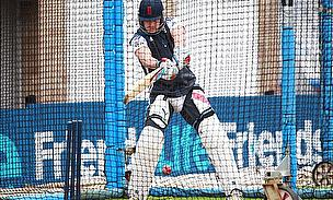 Nick Compton bats in the nets