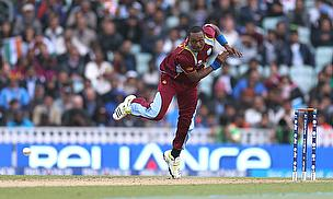 Dwayne Bravo bowls for the West Indies