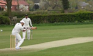 Fahad Jabbar of HCC 2nd XI square cutting Long Marston's Peter Head