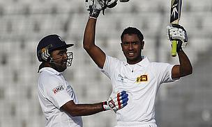 Kithruwan Vithanage (right) celebrates his maiden Test century against Bangladesh