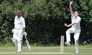 Ronnie Yates bowls during his four-wicket haul