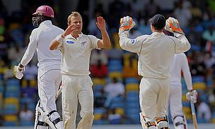 Neil Wagner (second left) celebrates one of his four wickets