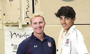 Darren Maddy prepares to feed Solihull's new bowling machine for cricketer Fahd Janjua
