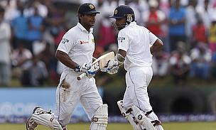 Kumar Sangakkara (left) and Mahela Jayawardene run between the wickets during their century stand