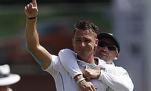 Dale Steyn celebrates a wicket with Dean Elgar