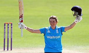 Charlotte Edwards raises her bat to celebrate her ninth ODI century