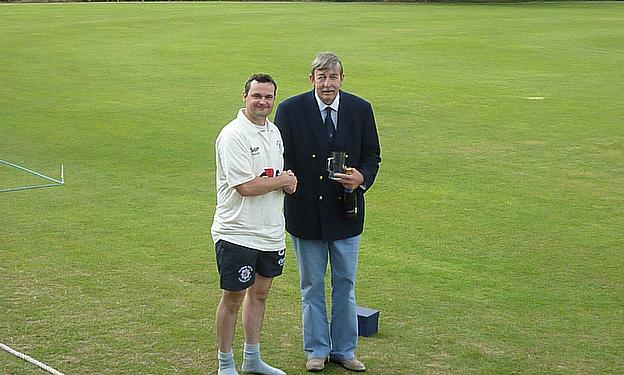 Former BPCC Chairman John Giffard presents Mick Martin with his man-of-the-match award